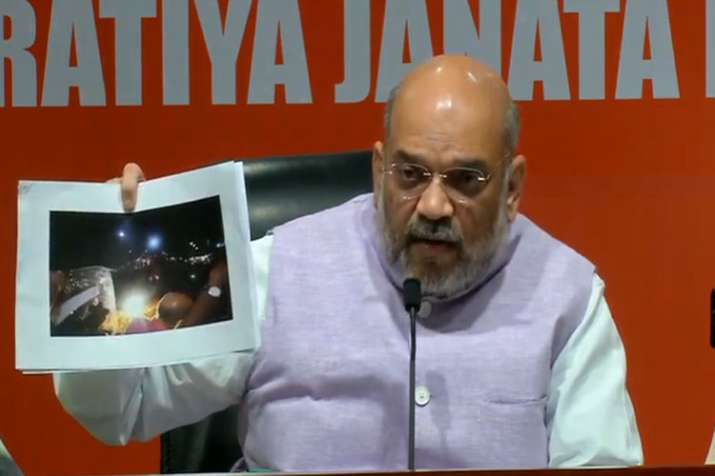 BJP National President Amit Shah during an election roadshow in Kolkata- India TV