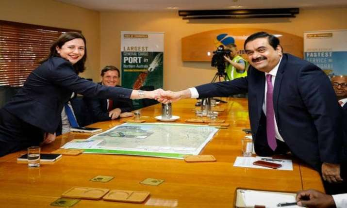 Queensland govt rejects Adani's plan to protect endangered bird species, delaying mine project- India TV Paisa