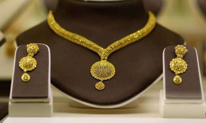 Gold slides on sluggish demand, silver firms up- India TV Paisa