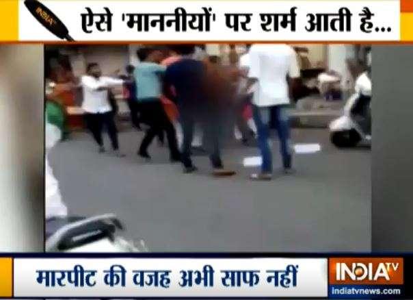 BJP's Naroda MLA Balram Thawani kicks NCP leader Nitu Tejwani - India TV