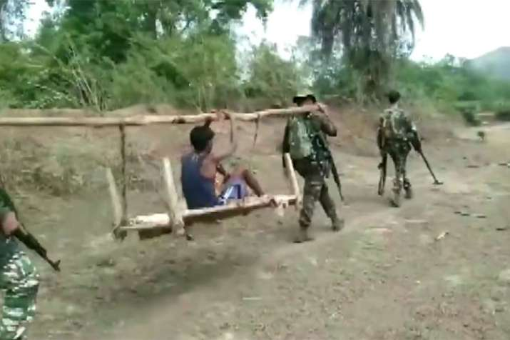 CRPF found a severely ill boy in a Chhattisgarh village and carried him on a cot for 8 km for treatm- India TV