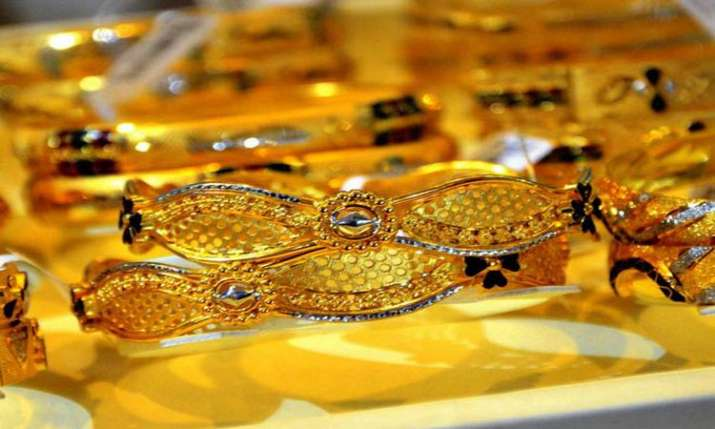 Gold glitters, jumps Rs 200 amid positive global market- India TV Paisa