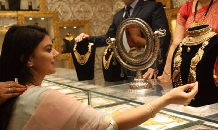 Gold rises on jewellers' buying, positive overseas trend- India TV Paisa