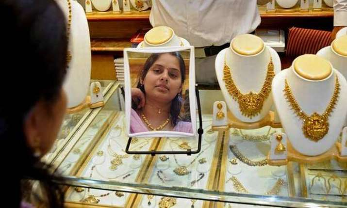 Gold, silver slide on easing demand- India TV Paisa