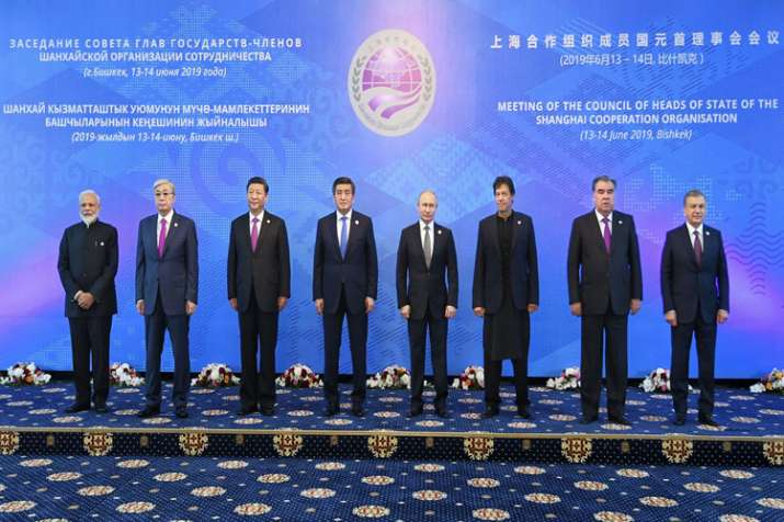 PM Modi pose for a photo before a session at the Shanghai Cooperation Organization summit in Bishkek- India TV