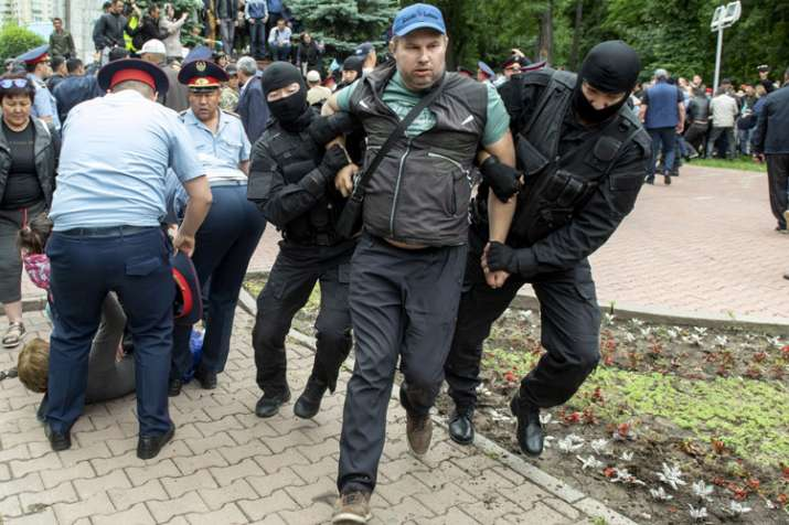 Kazakhstan police beat journalist amid post-vote unrest | AP- India TV