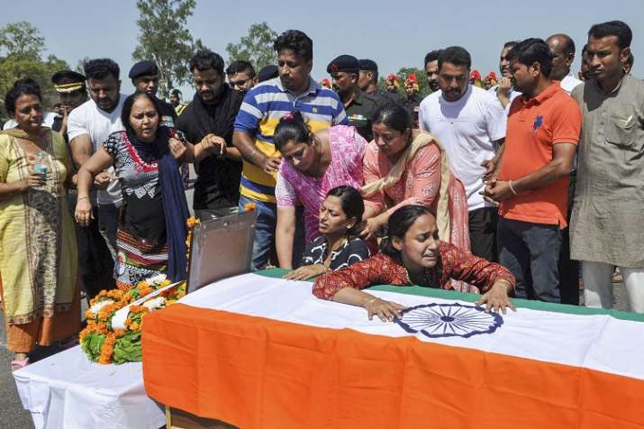 Family member mourns near the coffin of Major Ketan Sharma.- India TV