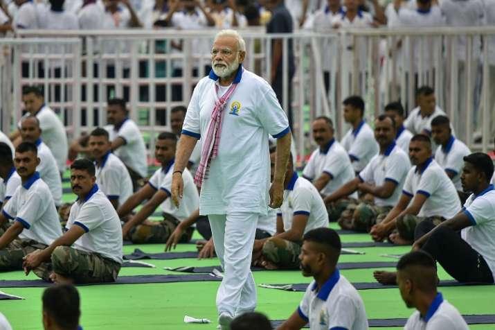 Prime Minister Narendra Modi during a mass yoga event...- India TV