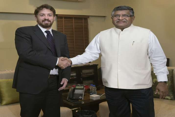 IT and Communication Minister Ravi Shanker Prasad shakes hands with WhatsApp's global head Will Cath- India TV Paisa