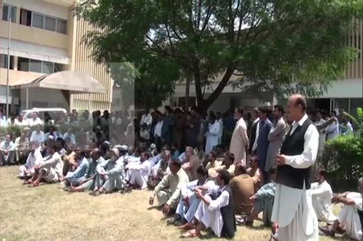 Government workers in PoK staged protest against the...- India TV