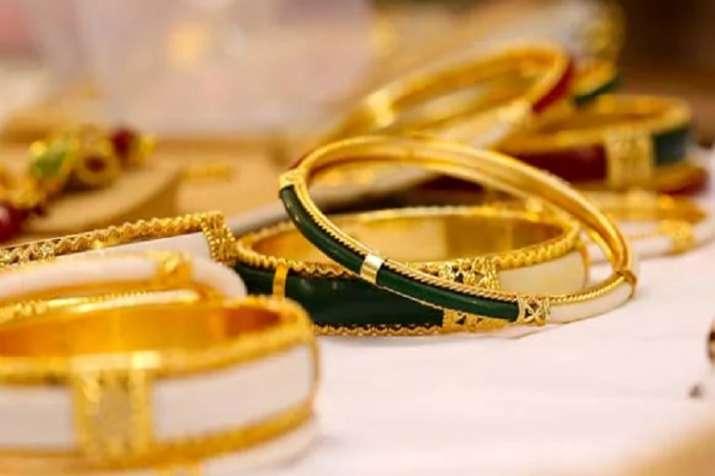 Gold futures weaken on global cues- India TV Paisa