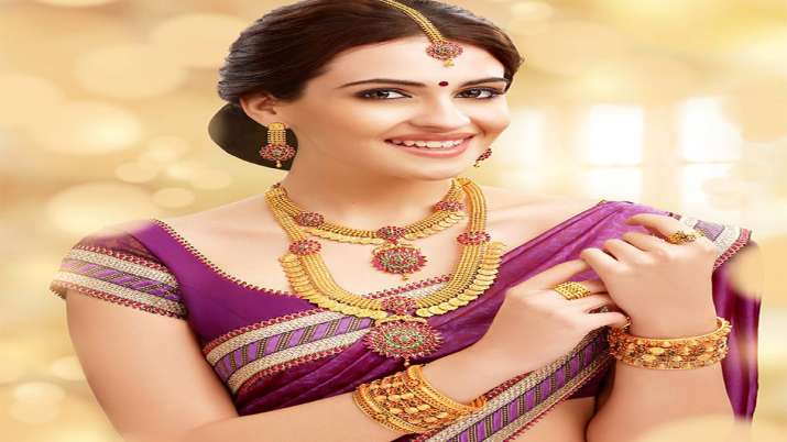 Gold slides Rs 70 on muted demand; silver jumps Rs 660- India TV Paisa