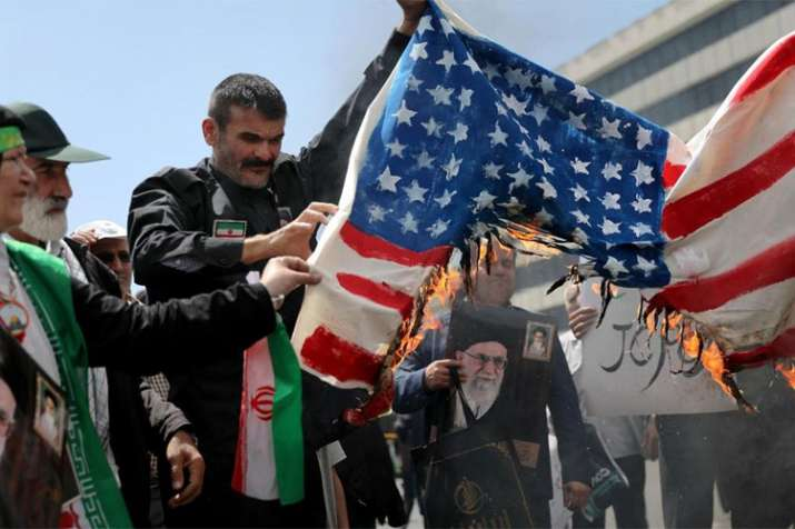 Protesters burn a US flag during a rally in Tehran| AP File- India TV