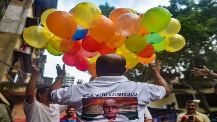 Supporters of Kulbhushan Jadhav celebrate on ICJ's...- India TV