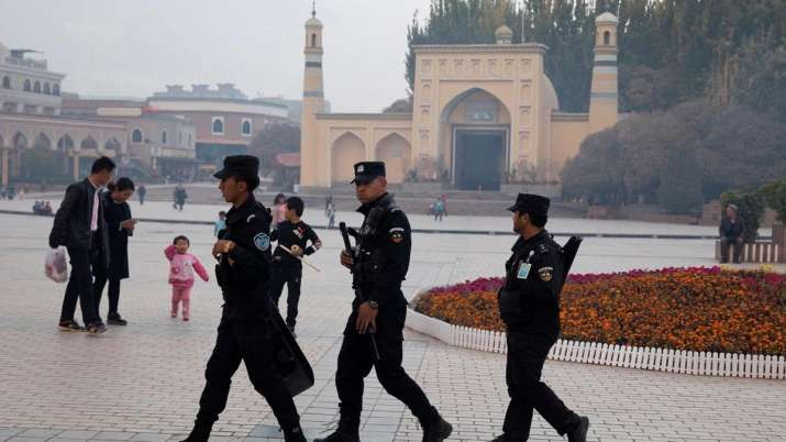 China defends training camps in Xinjiang, says it 'effectively eliminated' religious extremism   AP - India TV