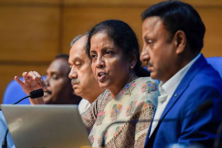 Finance Minister Nirmala Sitharaman with Finance secretary Rajiv Kumar during a press conference to - India TV Paisa