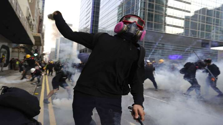 Hong Kong police fire tear gas in renewed clash with...- India TV