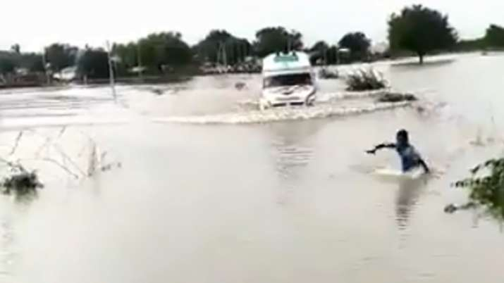 The 12-year-old braveheart puts his life in danger to lead an ambulance through a flood bridge in Ra- India TV