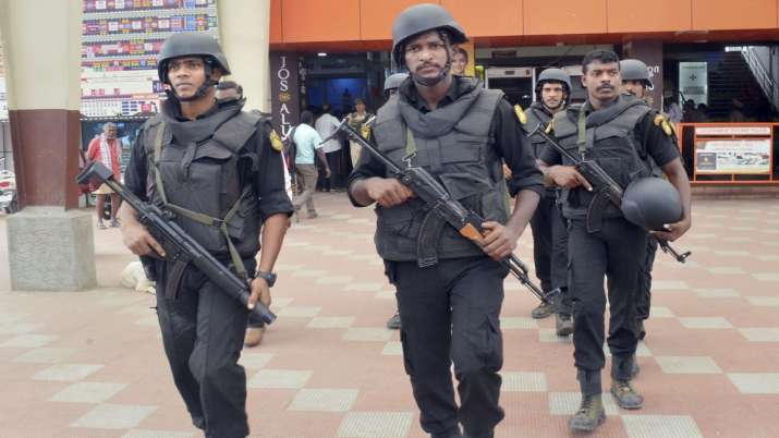 Commando force personnel conduct checking at a railway station in Coimbatore.- India TV