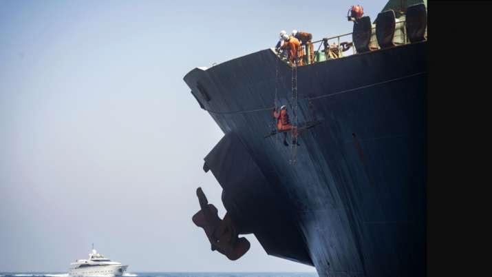 Gibraltar: Crew members of the Grace 1 super tanker remove the name of ship in the British territory- India TV