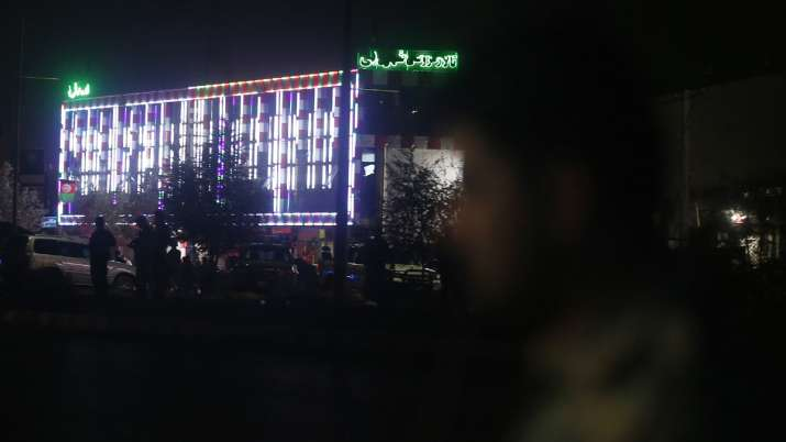 Afghan policemen stand guard outside the wedding hall after an explosion in Kabul, Afghanistan   AP- India TV