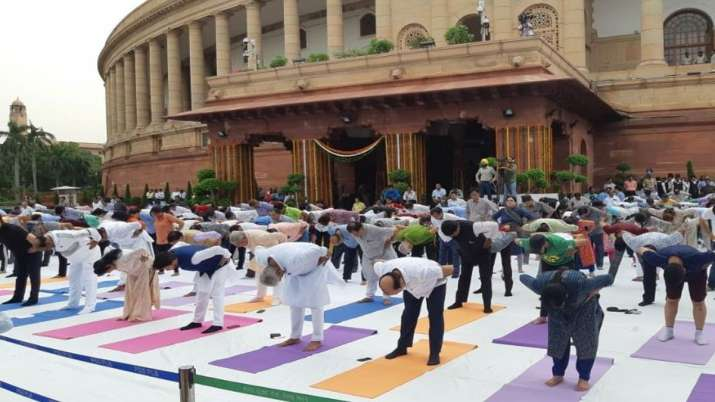 Members of parliament and officials of Lok Sabha, take...- India TV