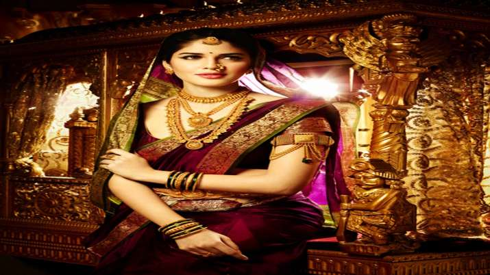 Gold prices fall Rs 372 on weak demand, strong rupee- India TV Paisa