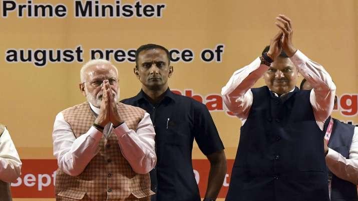 Prime Minister Narendra Modi with Maharashtra Chief Minister Devendra Fadnavis during the inaugurati- India TV Paisa