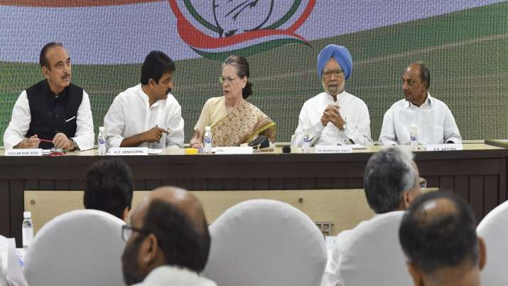 Congress interim president Sonia Gandhi, flanked by...- India TV