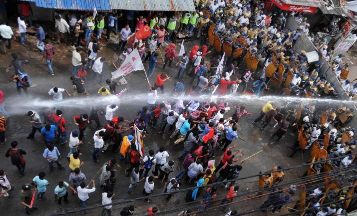 Police personnel use water cannon to disperse protestors...- India TV