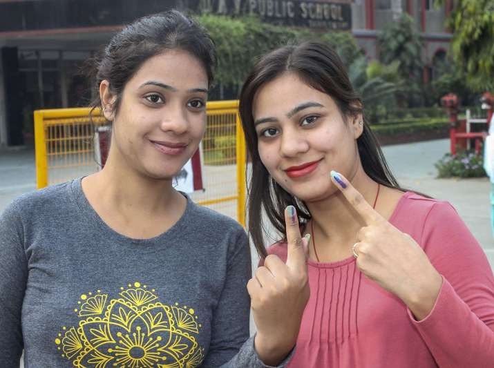 Voters show their inked fingers after casting their...- India TV