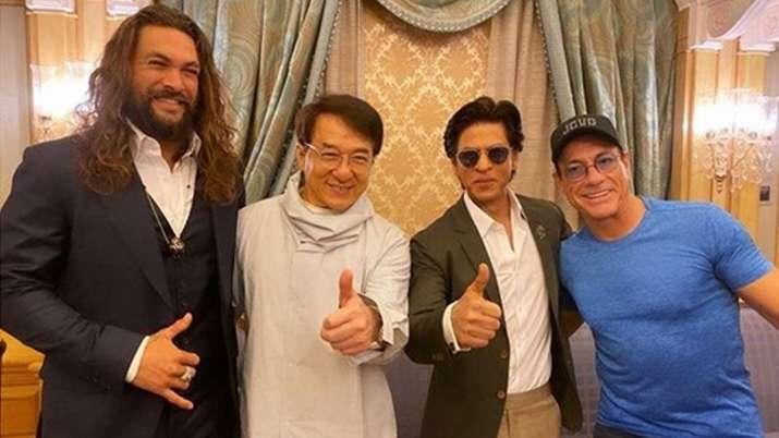 Shah rukh khan poses with jean claudevan damme jackie chan aquaman jason momoa- India TV