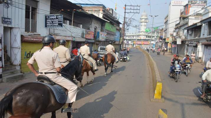 Mounted Police personnel patrol in a street as part of precautionary measures in view of Supreme Cou- India TV