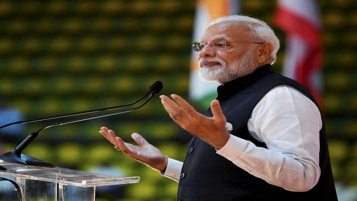 Prime Minister Narendra Modi gestures while addressing the crowd during the 'Sawasdee PM Modi' event- India TV Paisa