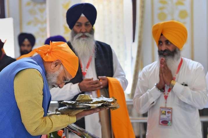 Prime Minister Narendra Modi receives 'parsad' after...- India TV