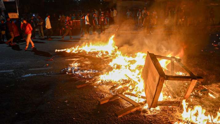 Protestors burn tyres and public property on road during...- India TV