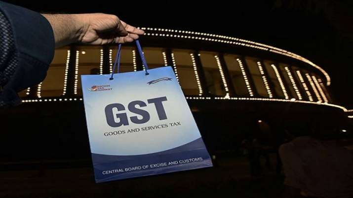 Hike rate, prune exemption list to increase revenue, Report of officers' panel on GST revenue- India TV Paisa