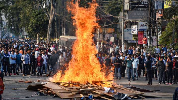 Protestor's burn hoardings and other materials...- India TV