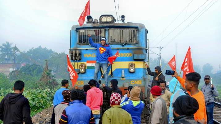 Members of AITUC and INTUC block a train during the...- India TV