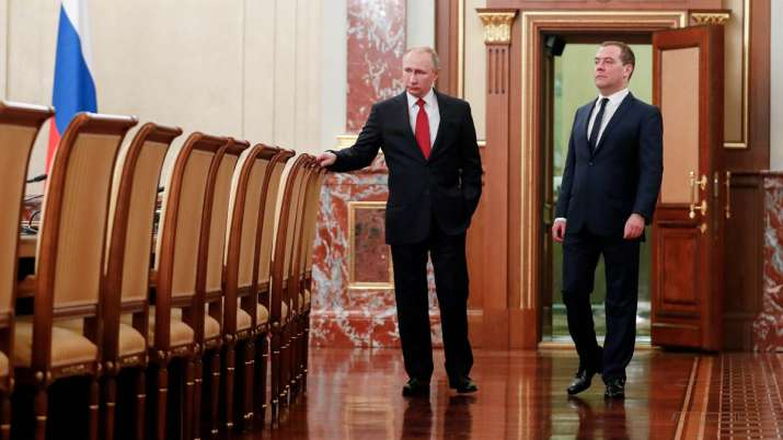 Russian President Vladimir Putin (Right) and Russian...- India TV